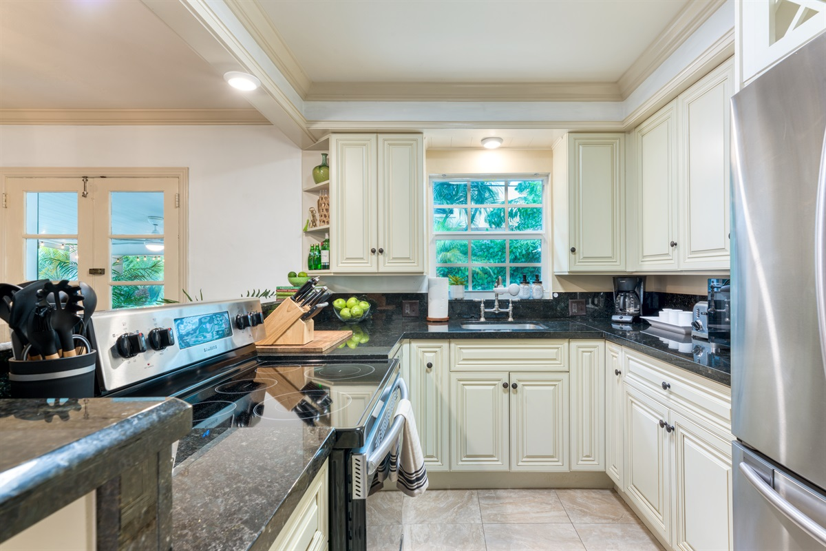 Wonderful kitchen with stainless steel appliances, black granite counter tops, drip coffee maker and everything else you need to create that perfect meal.