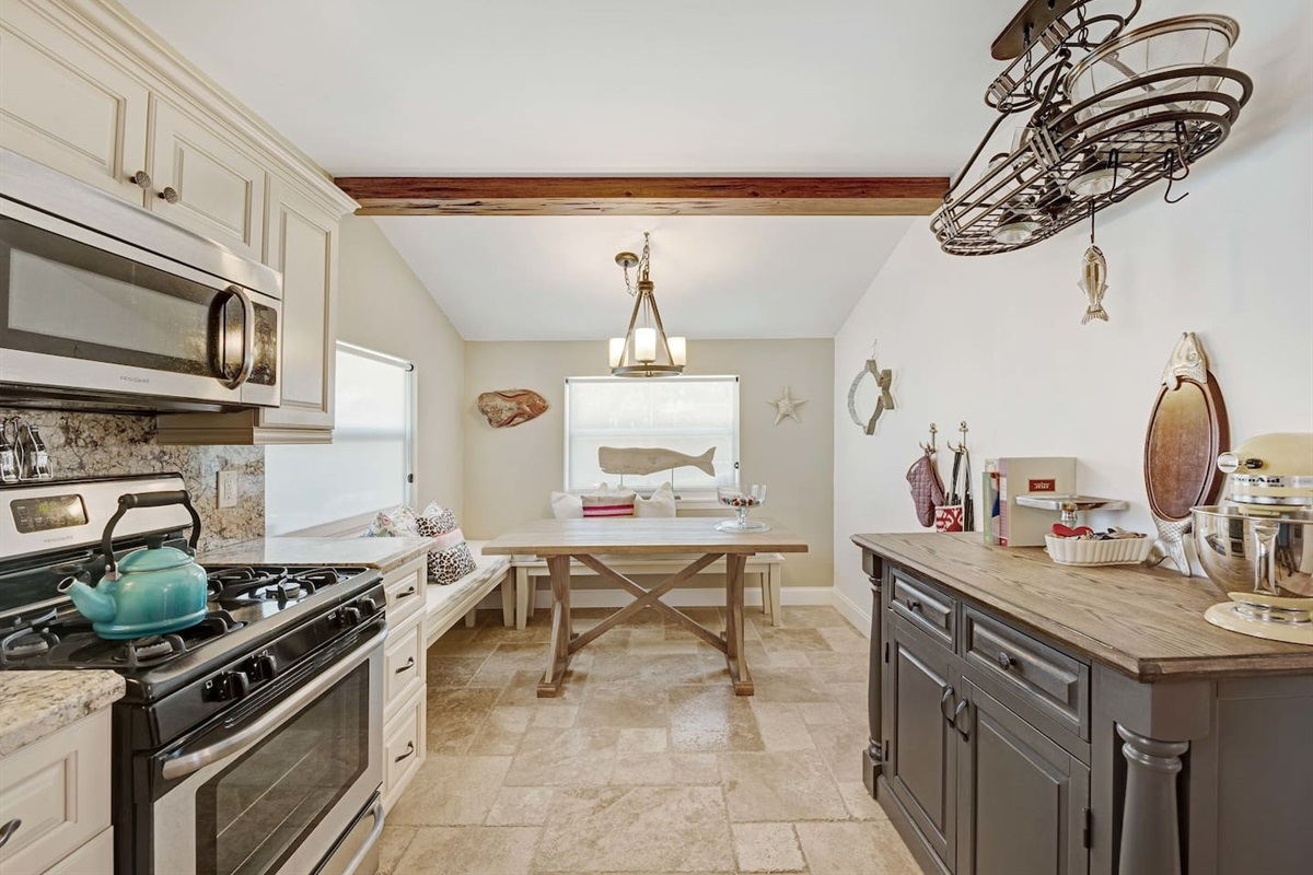 This country style kitchen is so cozy with a fantastic nook to enjoy breakfast with the family.