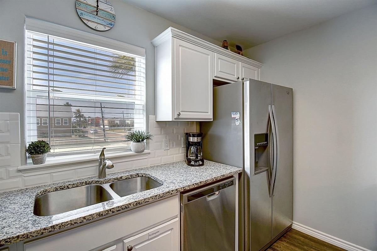 Double Door Refrigerator with Icemaker & water dispenser.