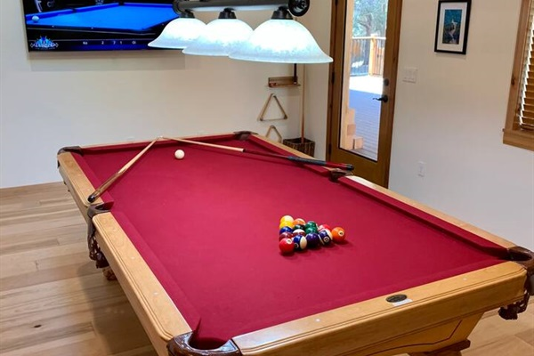Play pool while watching your favorite program on the flatscreen.
