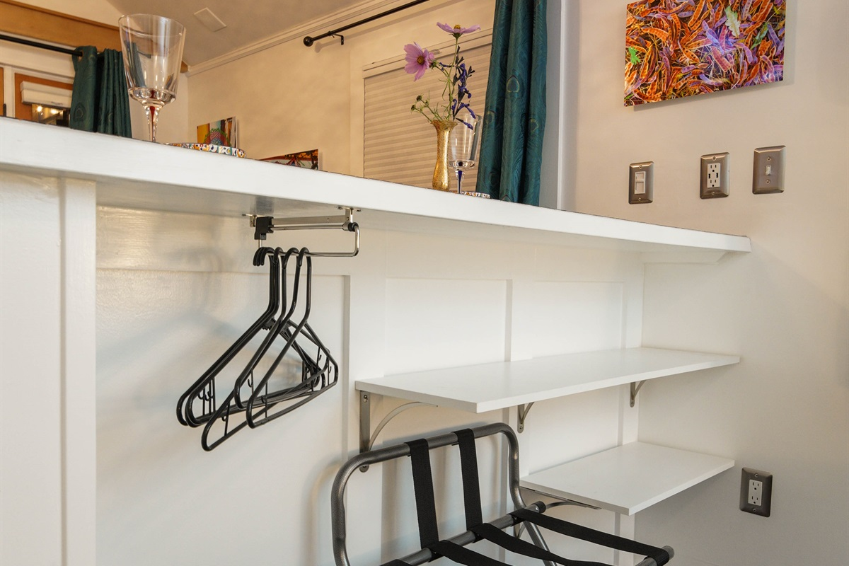 More shelves, hangers, and luggage rack under the dining bar.der