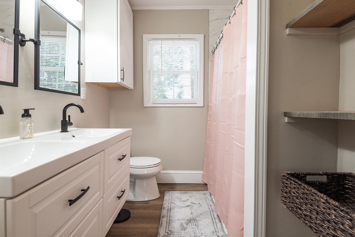 Bathroom #2 with tub/shower combo, duel sinks, hair dryer & plenty of room for toiletries