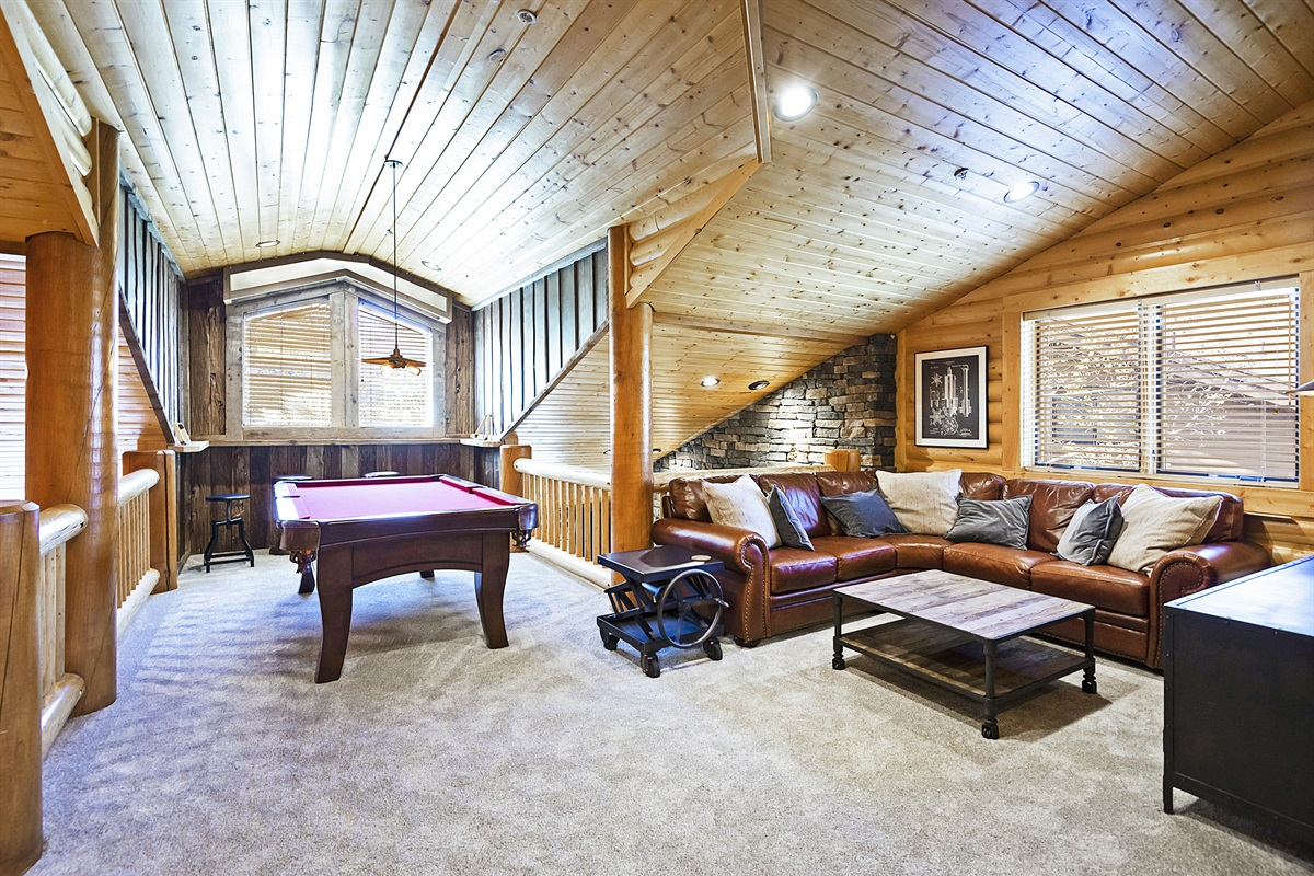Upstairs - pool table, bar area, family room, TV