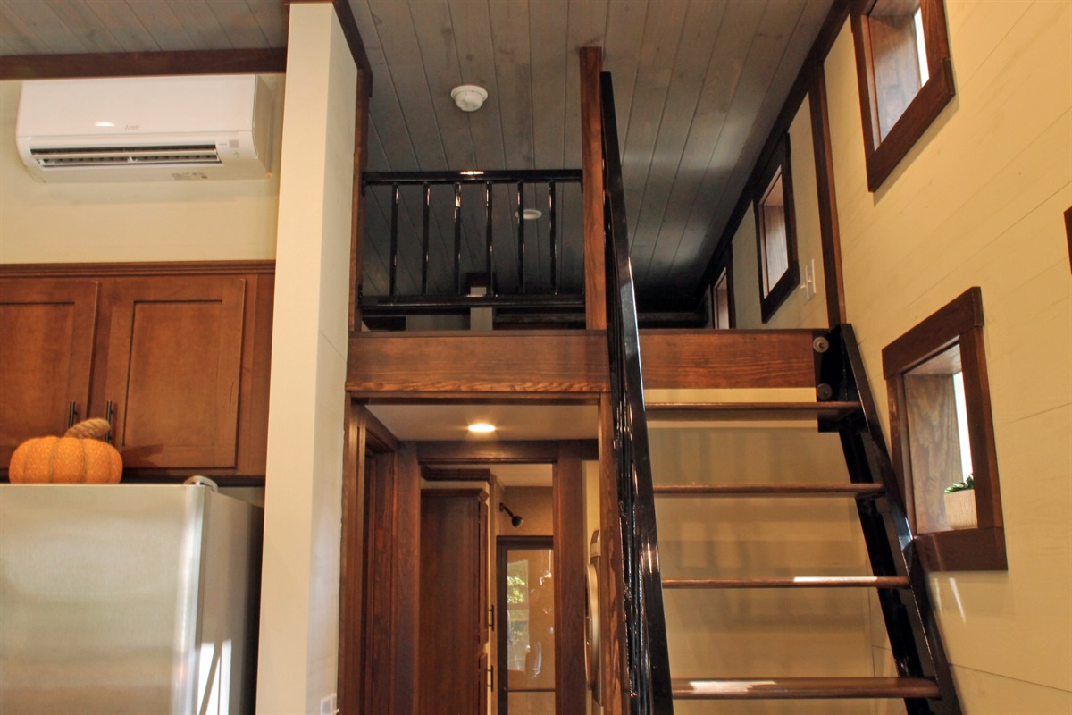 Stairs Up To Loft Area With Two Queen Size Beds