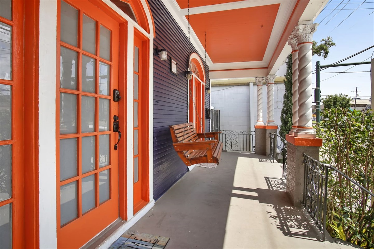 Front covered porch with swinging bench.
