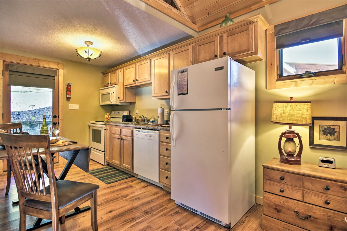 The kitchen is fully equipped with up-to-date appliances