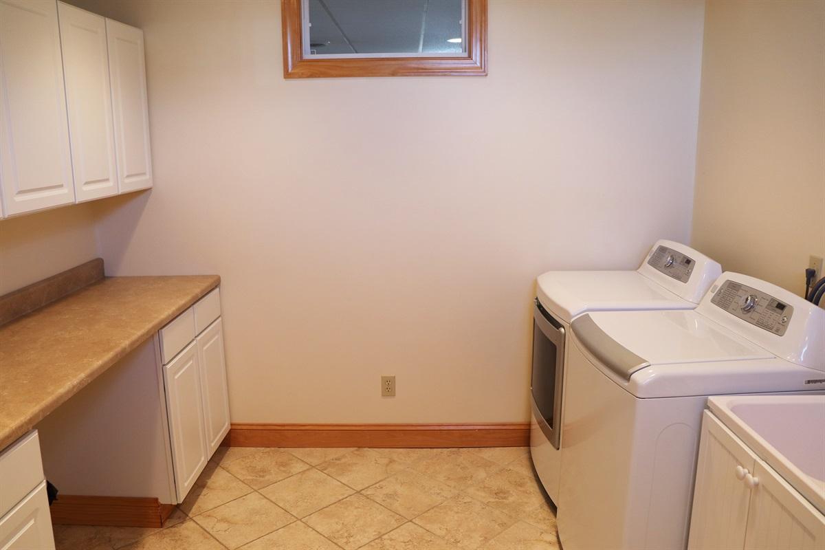 Large lower level laundry area.