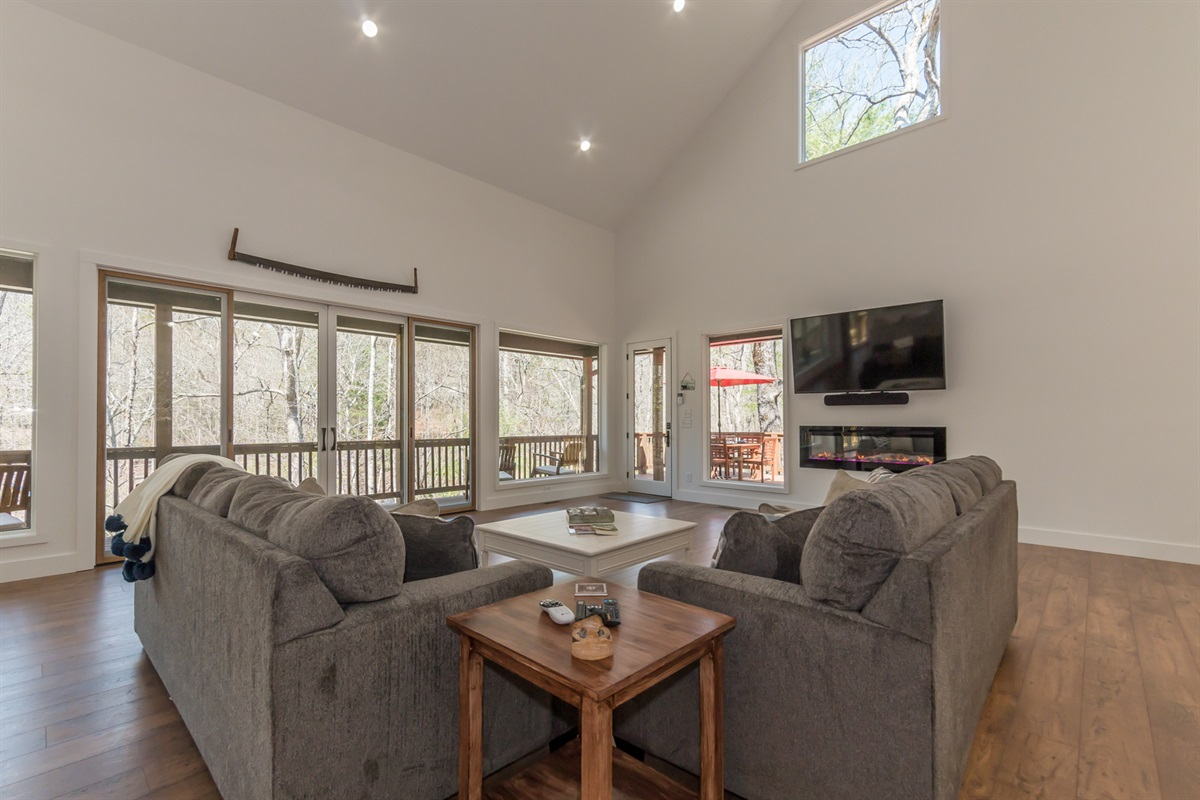 Open Living Room with Big Screen TV and Fireplace
