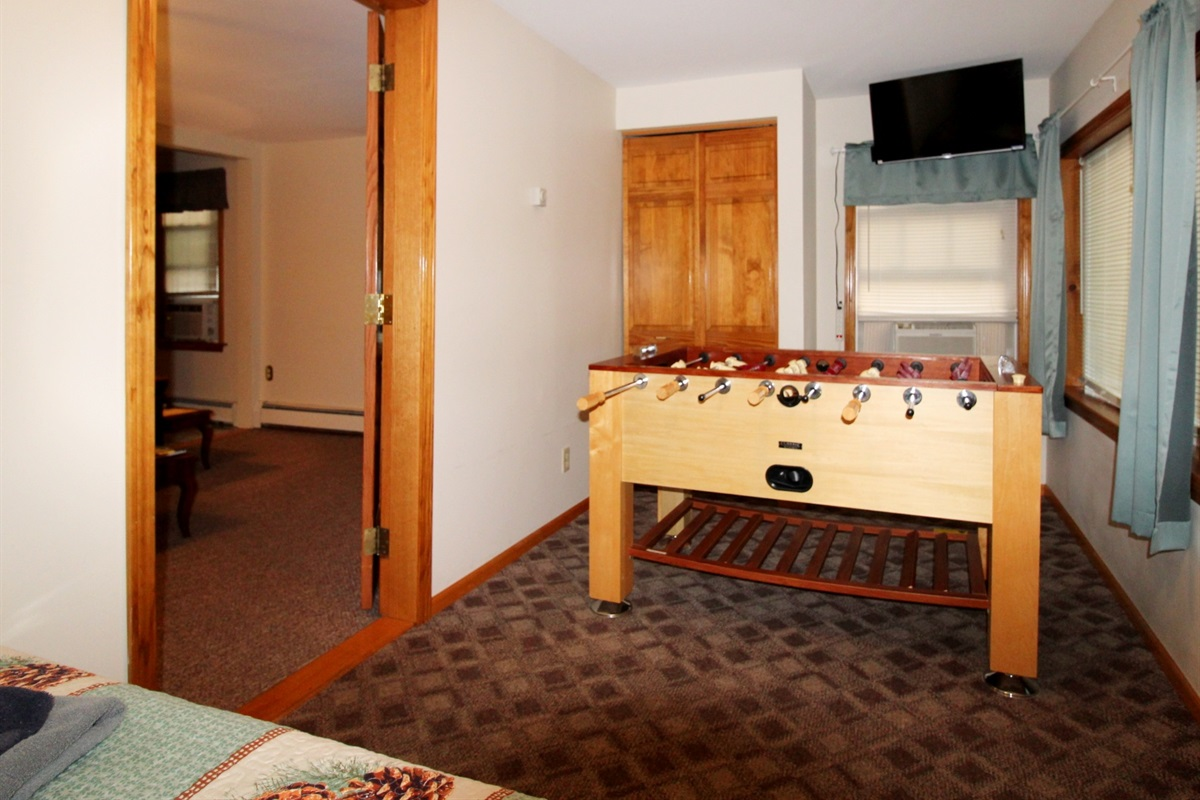 Foosball area in front bedroom with large flat screen smart Roku TV