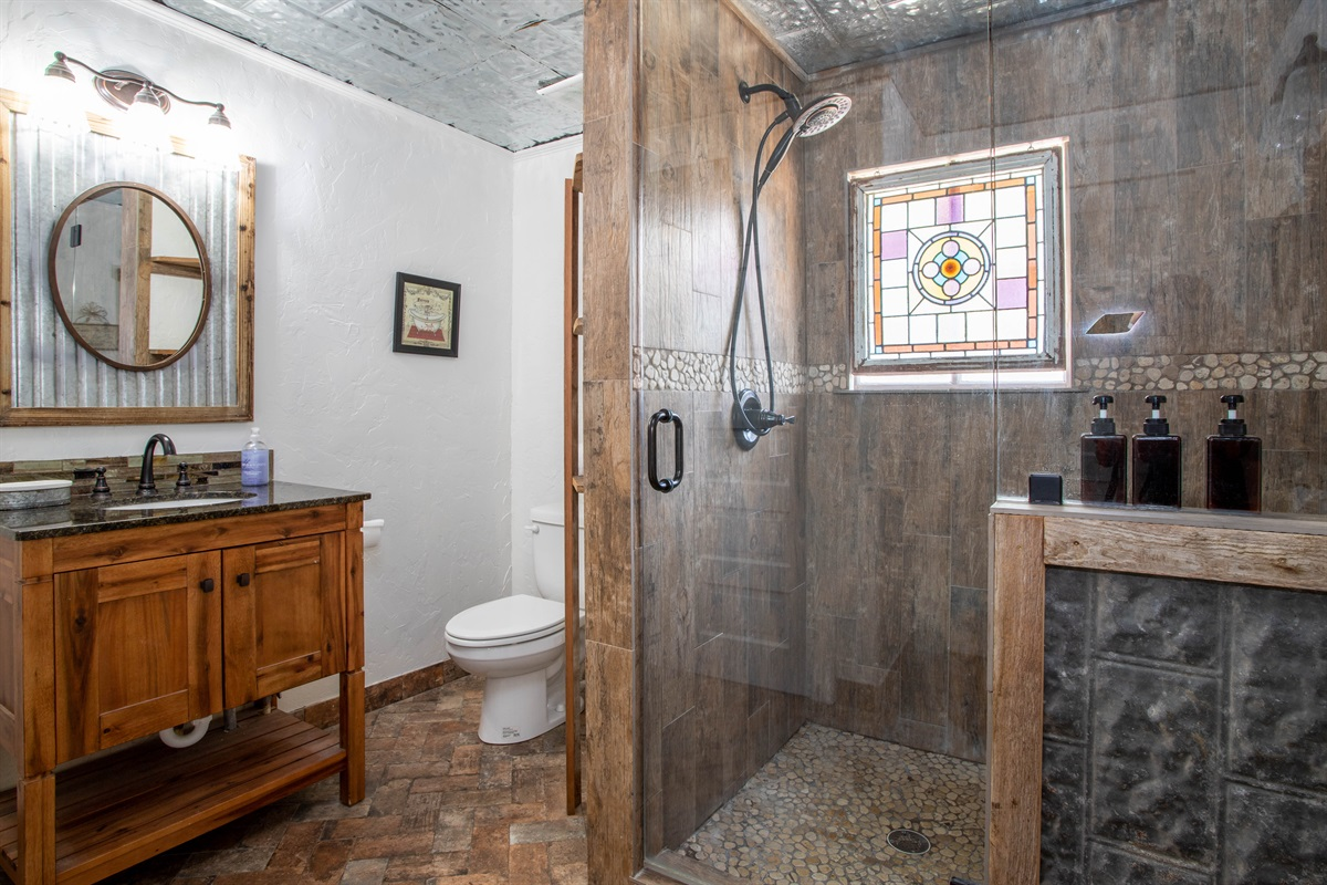 Bathroom 1: Refresh in the walk-in shower while enoying the ambiance provided by stained-glass
