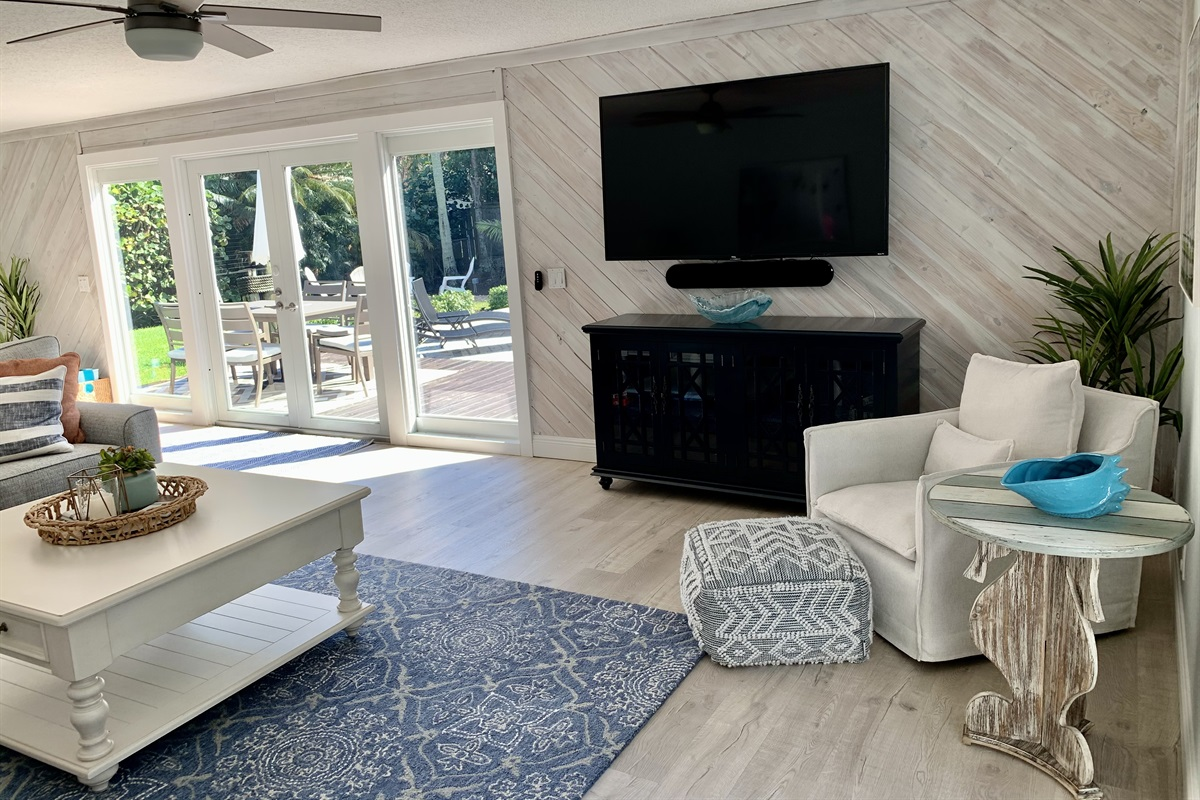"""2nd Living room with 65"""" TV, pull out Queen TempurPedic Sofa overlooking pool!"""