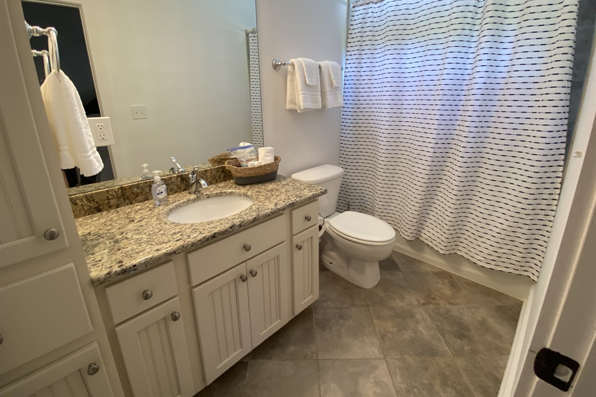 """Spunky-Teen Room en-suite bathroom. Fresh white linens and travel size bathroom essentials."