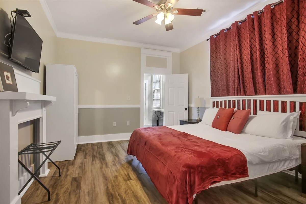 """Bedroom 2. 1 king bed, blackout curtains, 39"""" cable tv, armoire. Jack & Jill bathroom."""