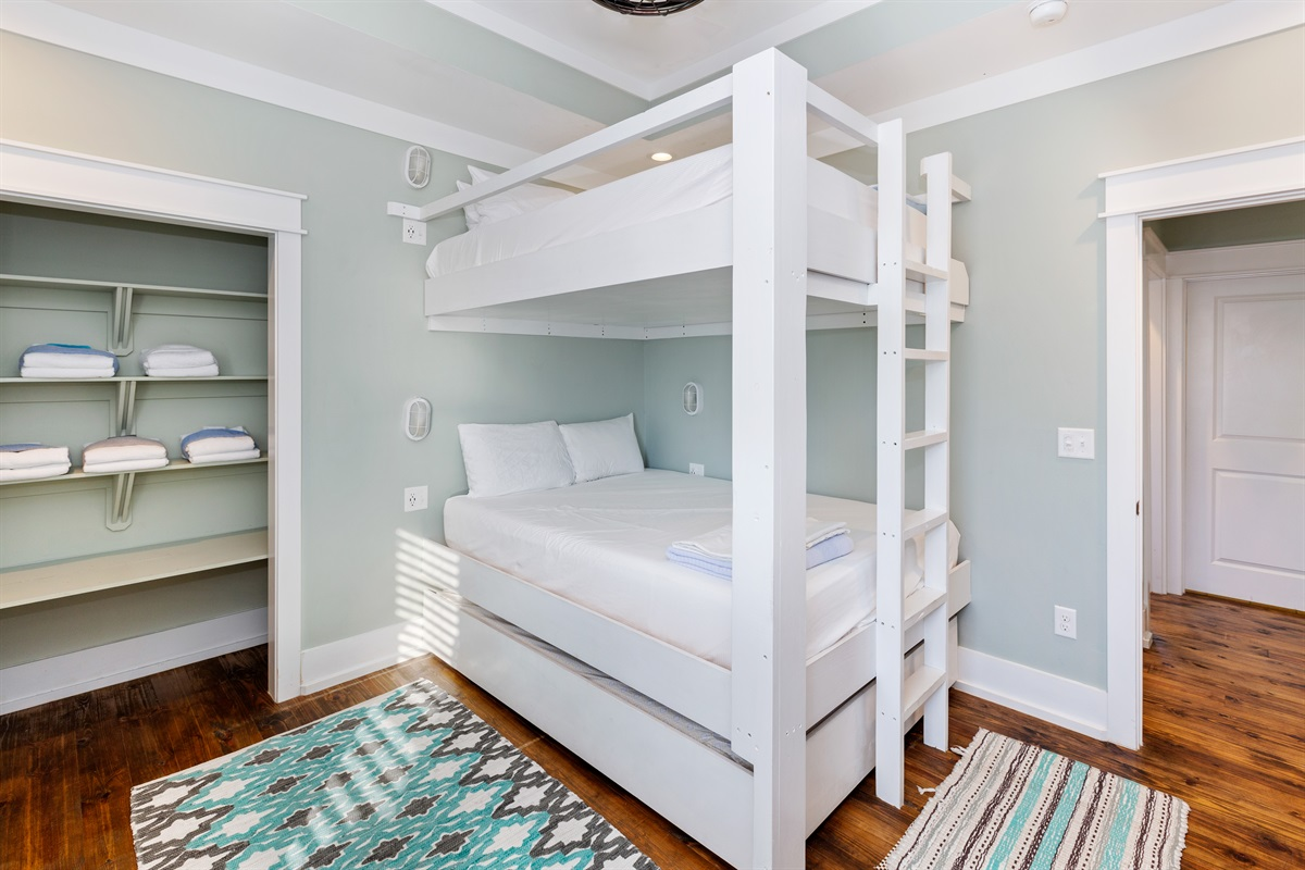 Custom-built, adult-sized queen bunks enable you to sit upright on the upper AND lower bunks. A twin XL trundle bed pulls out from below to offer sleeping accommodations for up to 5 in this third floor bunk room.
