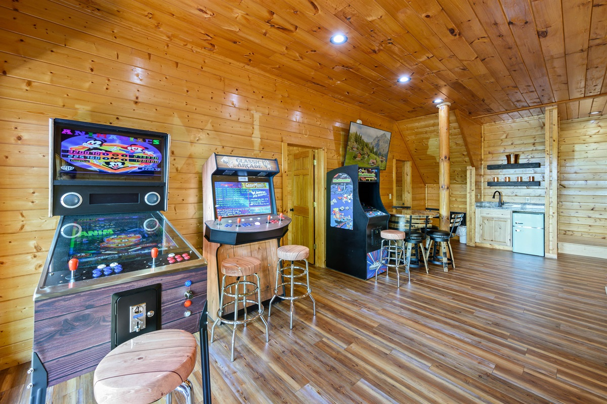 Bottom Floor is a kids playground.  Multiple 65 inch Smart TV's, New Pool Table, New 8 person Hot Tub, 3 Arcade Games with +4,500 Games, and Wet Bar complete with retro fridge!