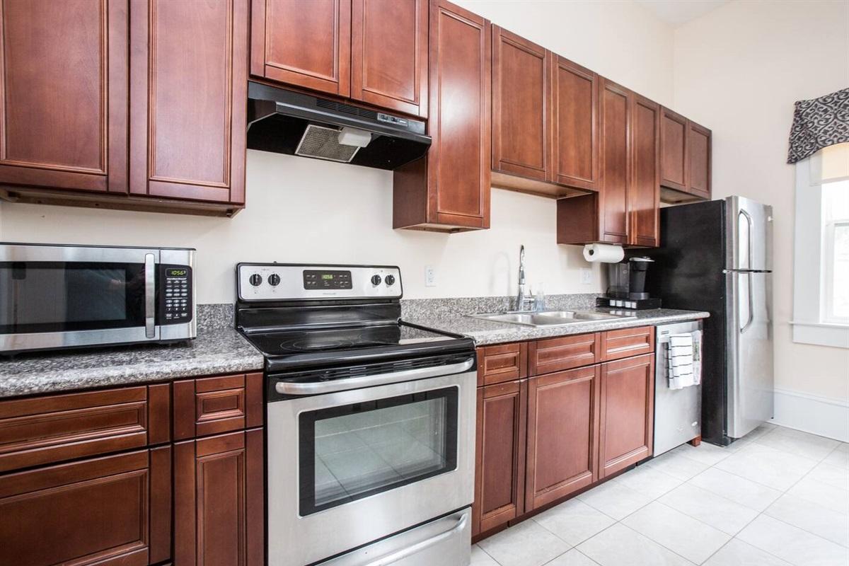 Kitchen.  Keurig coffee maker, fridge, oven/range, dishwasher, microwave.  Dishes, pots, pans, etc.