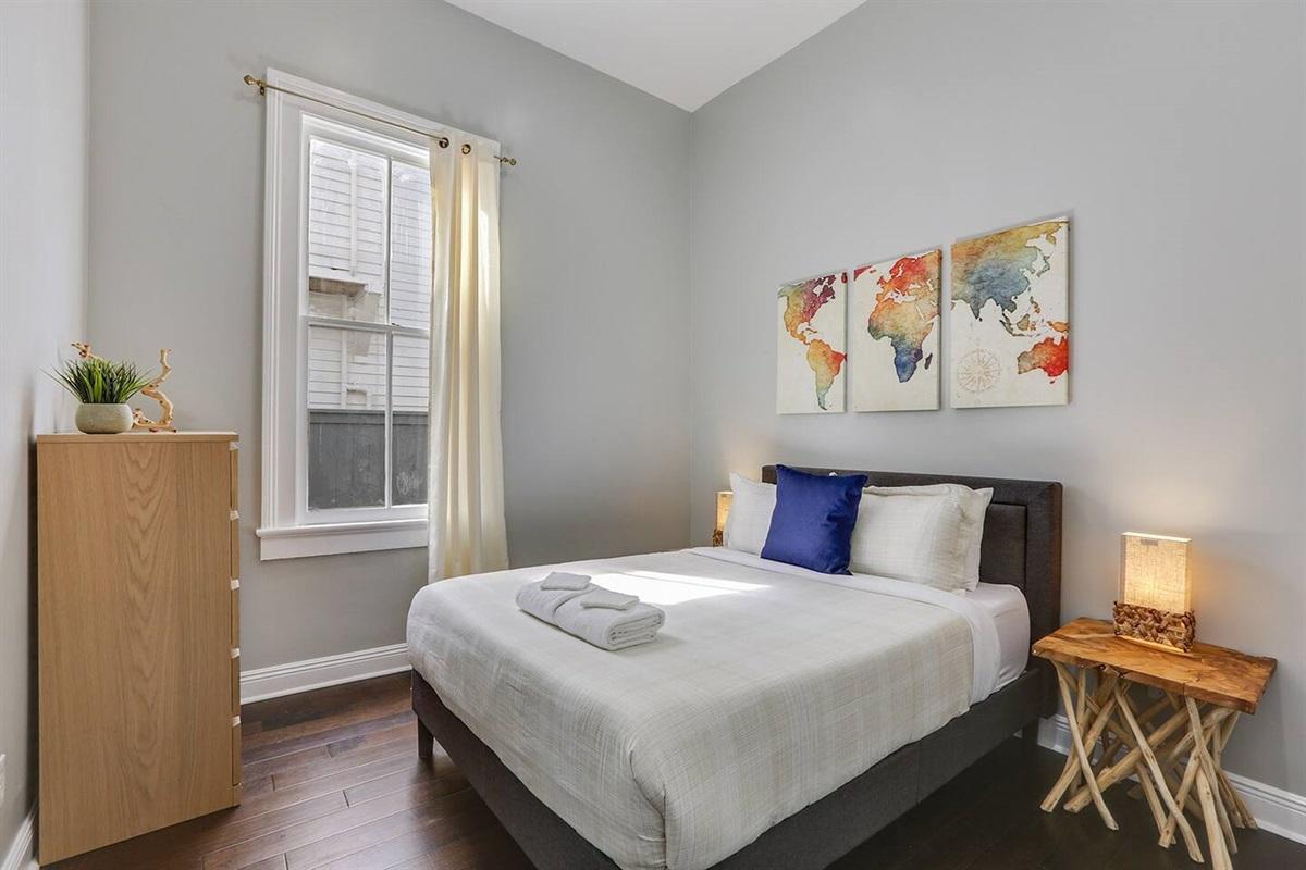 Bedroom 4. Queen bed. Dresser.
