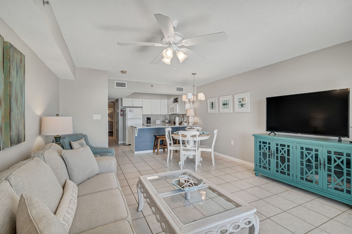 Spacious Open Concept Living Area with Large Flat Screen TV
