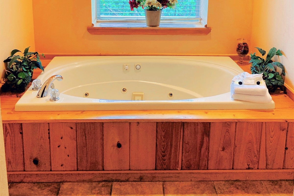 Jetted tub in Hall shared bathroom