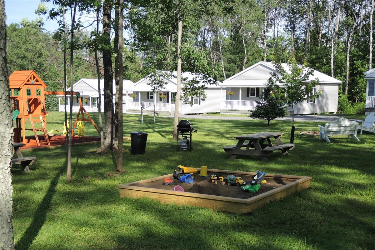 Sandbox, swingset and cottages