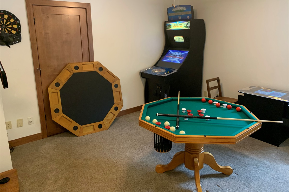 GAME ROOM! With bumper pool table, poker table, Golden Tee golf game, 1500 arcade table, and dart board.