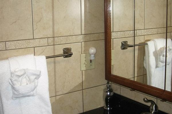 Modern fully tiled bathroom