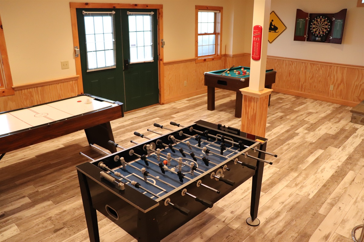 Lower level game room, foosball, bumper pool and air hockey.
