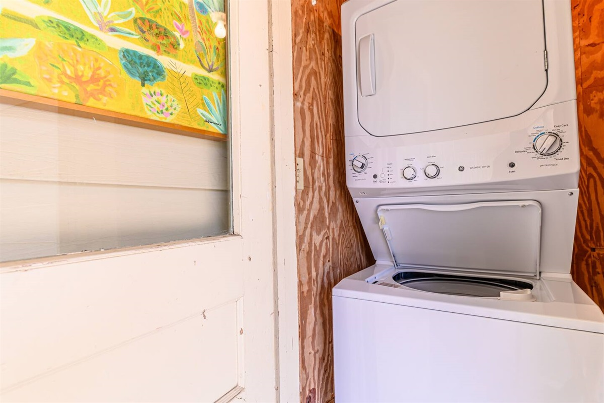 The laundry area is located in the front lanai behind the blue door.