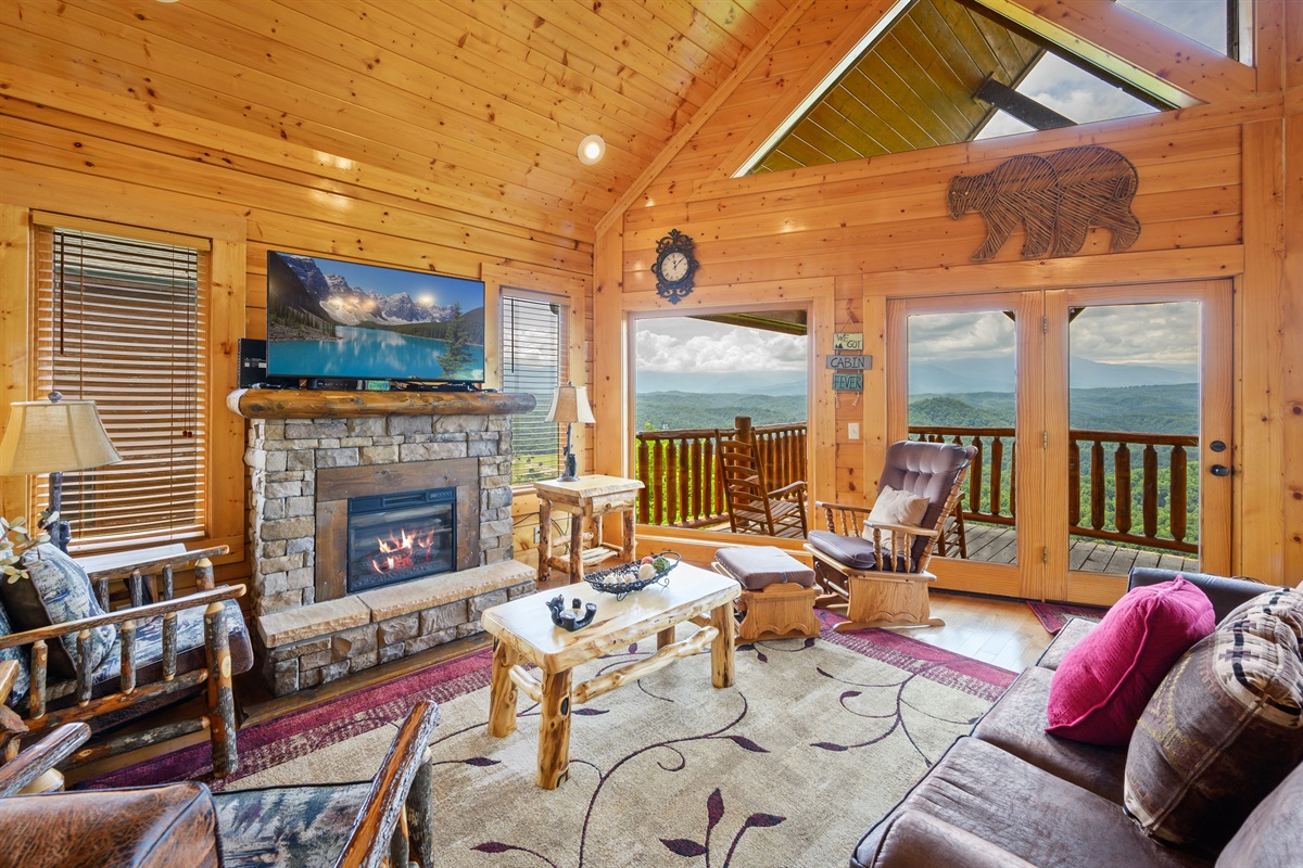 Living room has a stack stone electric fireplace