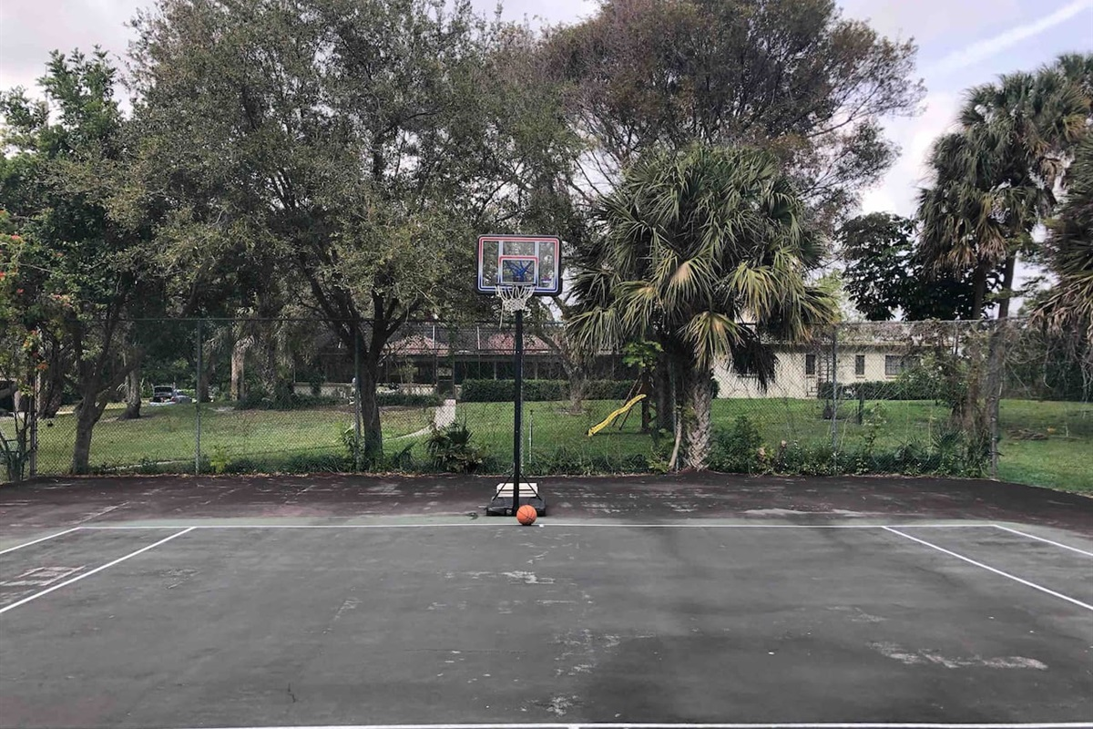 Basketball hoop on tennis court