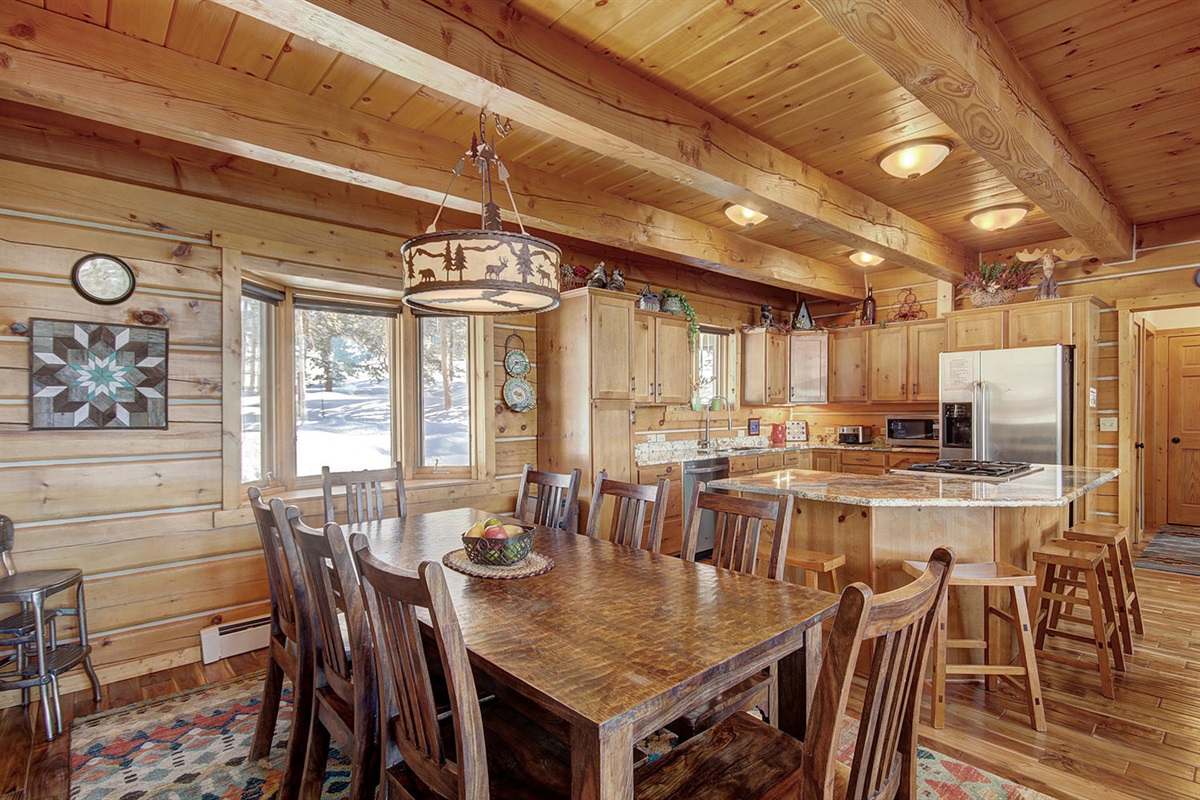 Dining seats 8 with kitchen island near by