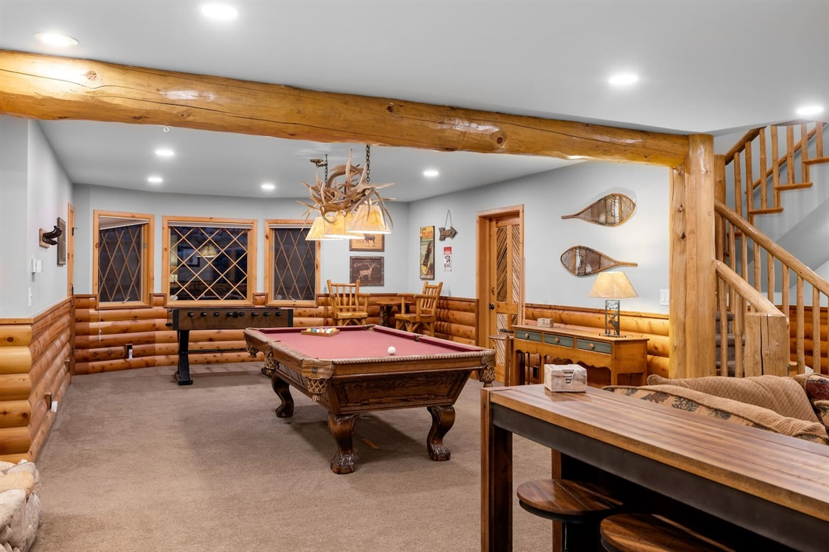 Large downstairs game room with pool and foosball. Gas fire place and direct access to the downstairs deck