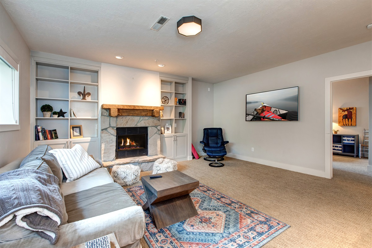 """Downstairs Family Room - Fireplace and 72"""" Flatscreen"""