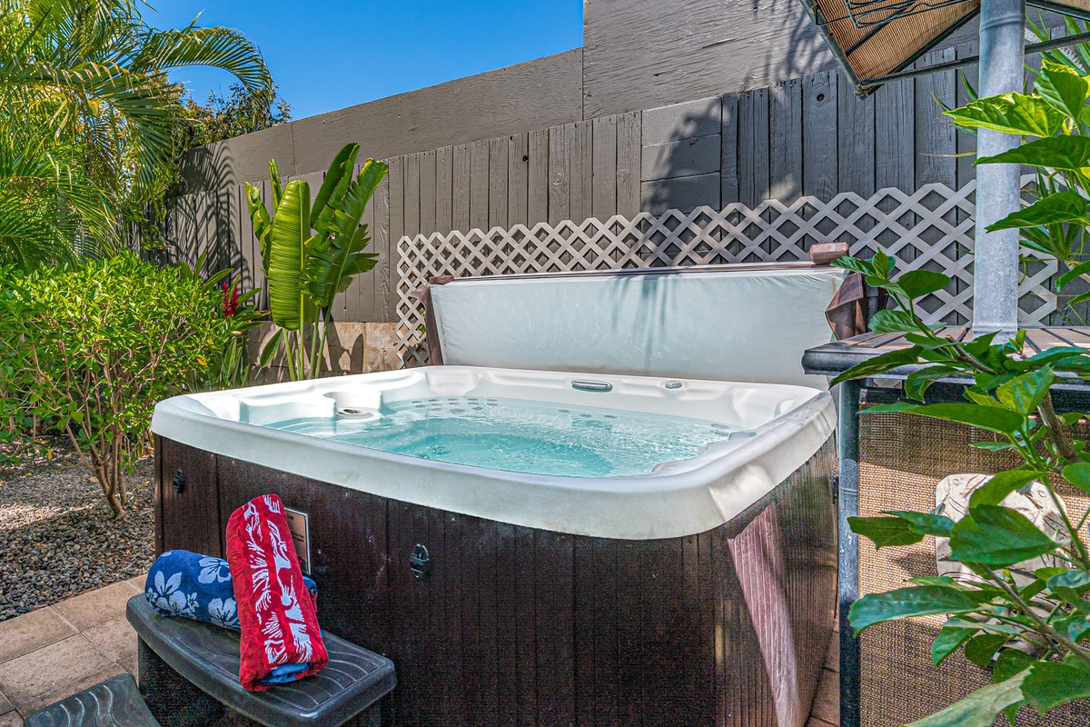 Secluded 6-person hot tub with a hot water outdoor shower