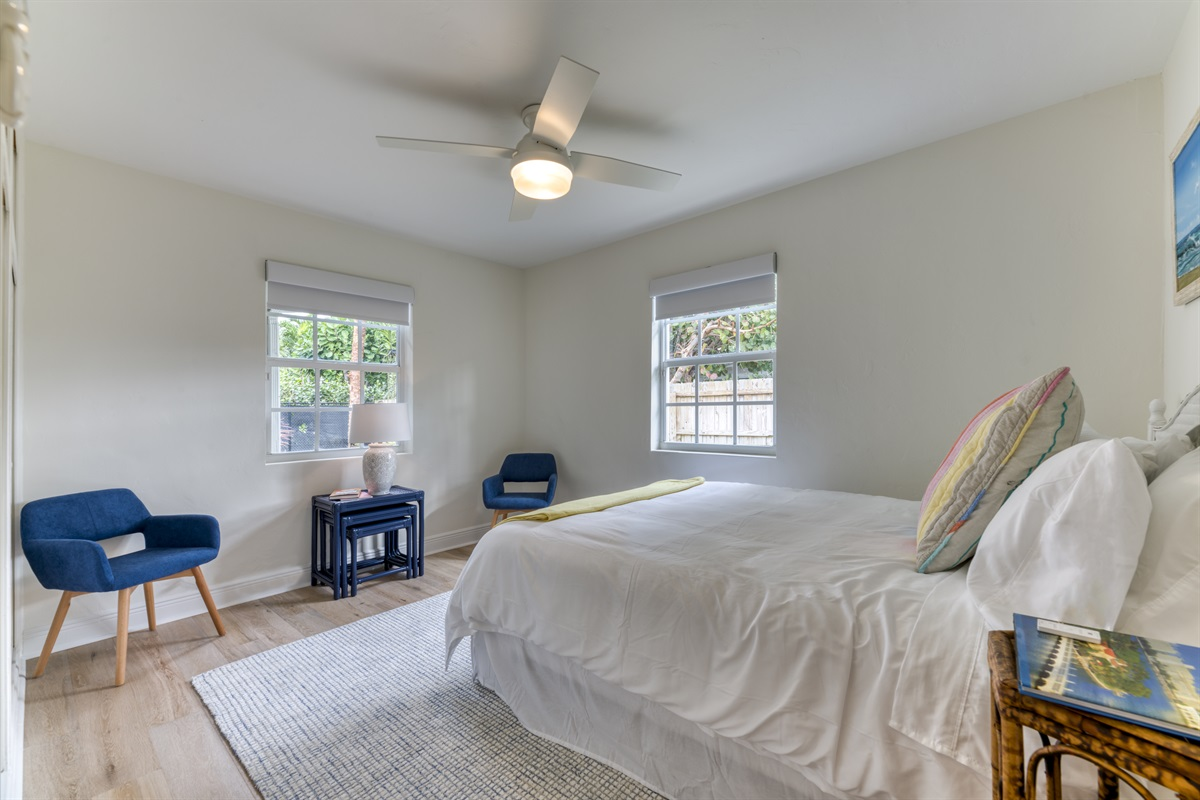 2nd Bedroom with Queen bed, automatic electric room darkening shades.