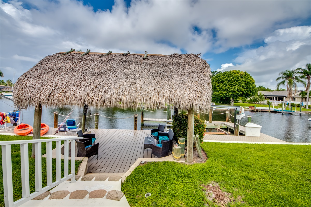 Walk from lanai to private tiki hut and dock