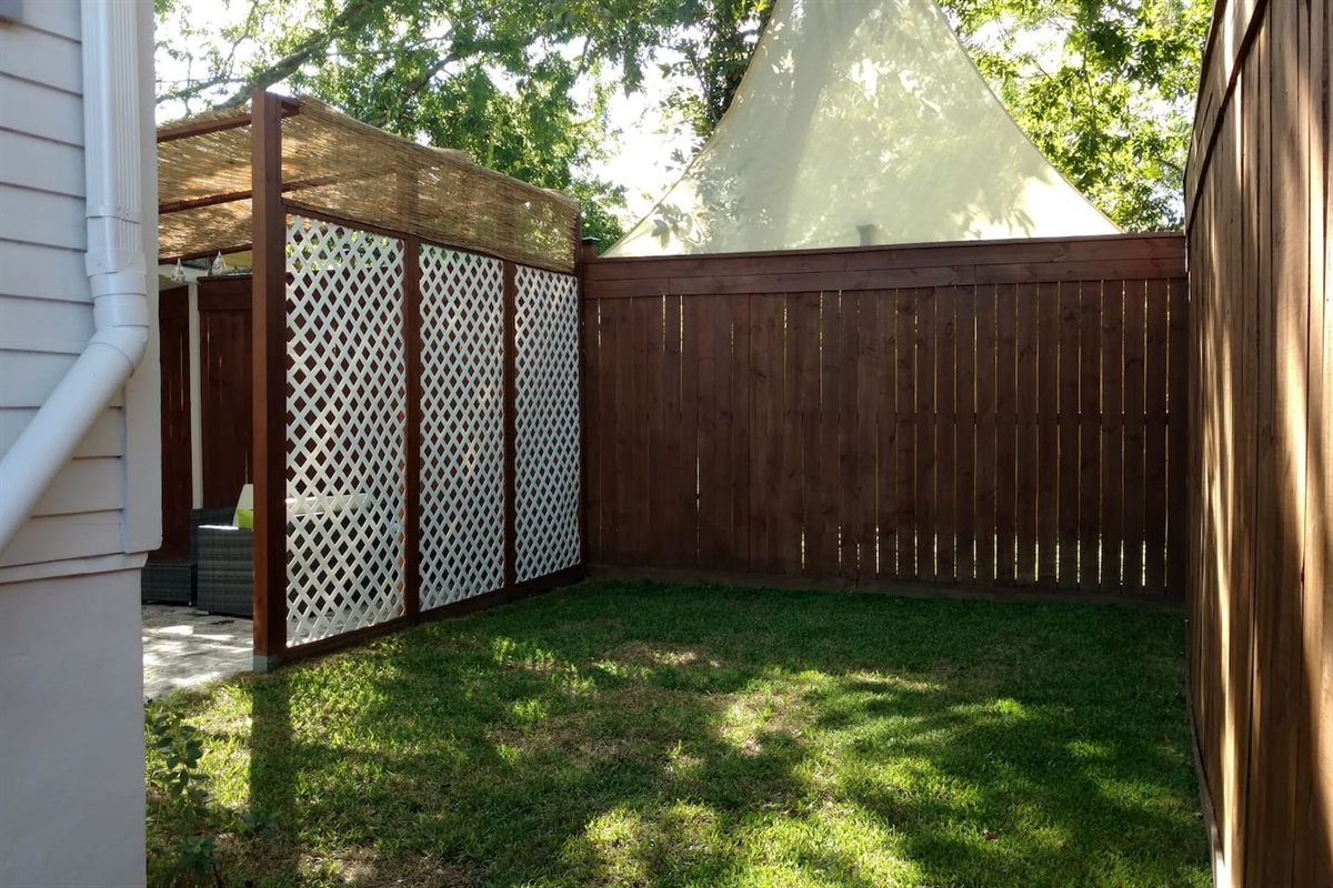back yard play space. Please note, this is in spring. Grass does not grow in winter/fall.