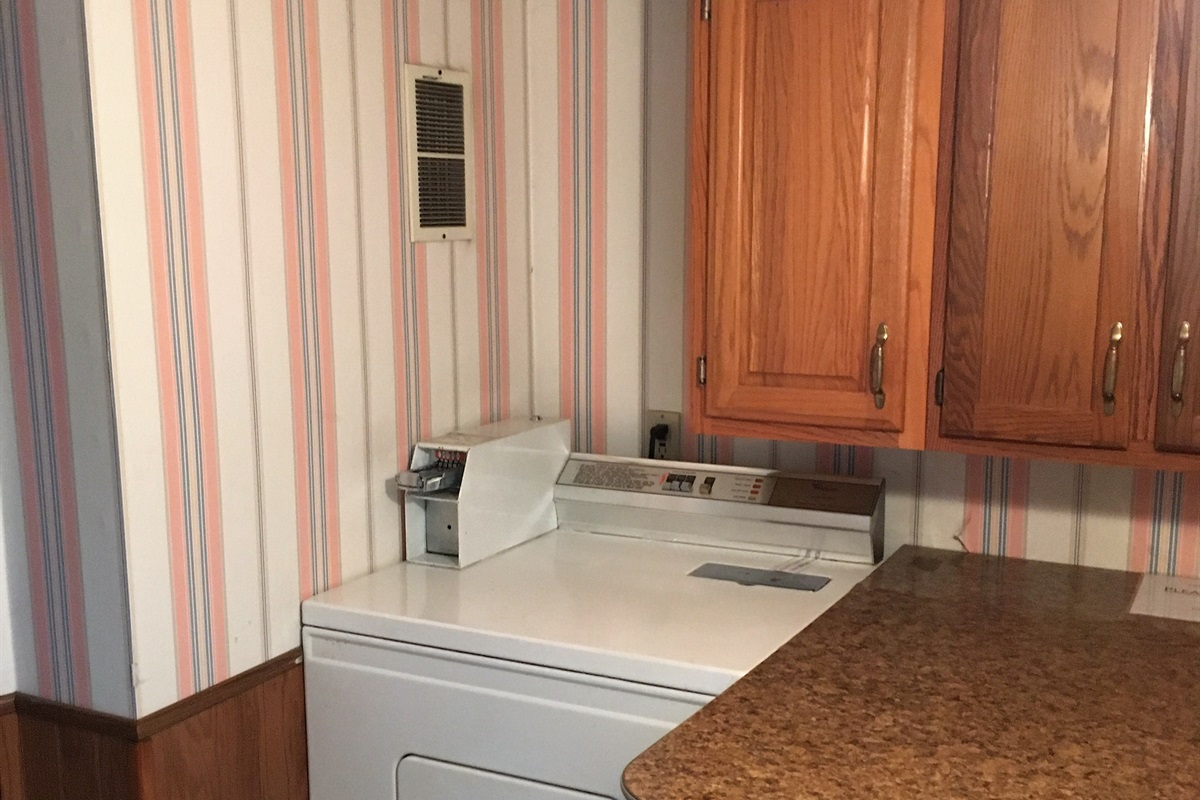 Dryer and laundry folding area - Laundry is FREE for our guests (yes, it is coin -op, but we provide the quarters!)
