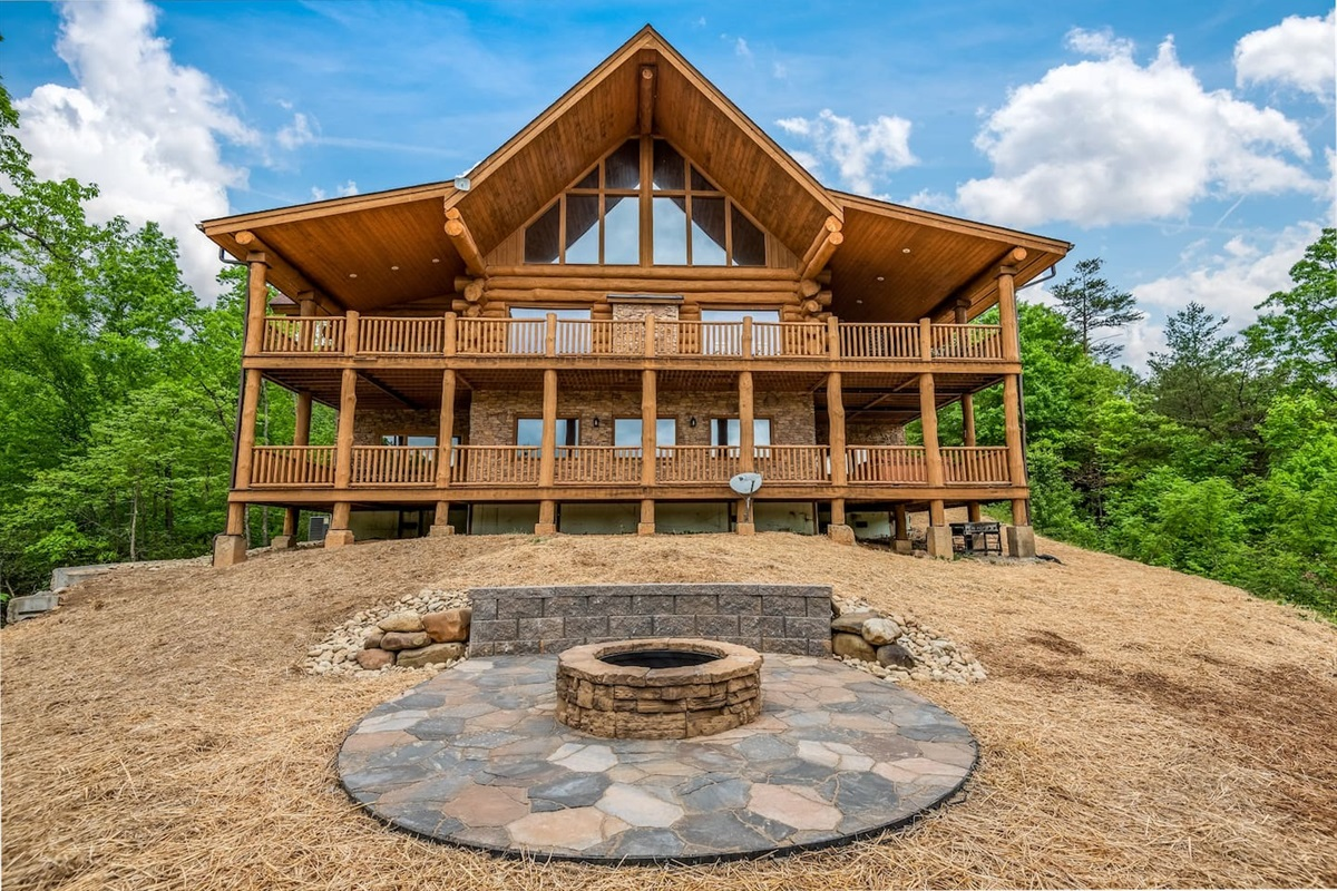 View of the cabin and the new landscaping and firepit (the grass has now taken hold).