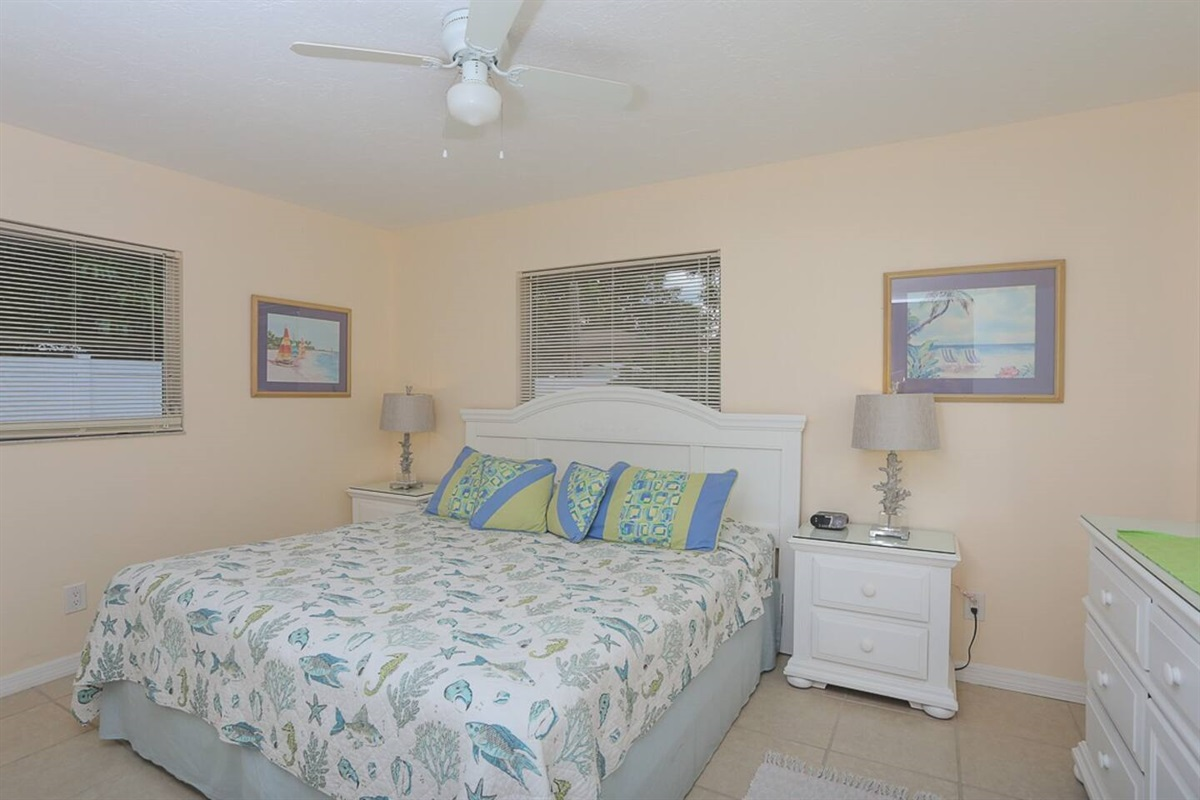Master bedroom with king size bed and large closet.  Large bedroom dresser with mirror and two bed side tables