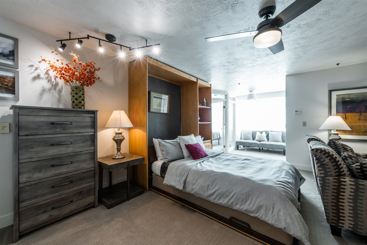 Queensize Murphy bed folds down without having to move the furniture.  Folds away without having to undo the bedding.  EASY!