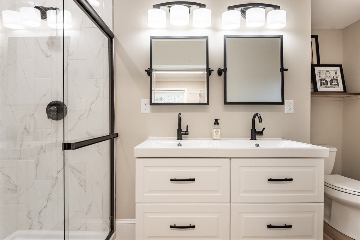 Master Bathroom with shower, duel sinks, hair dryer & plenty of space for toiletries
