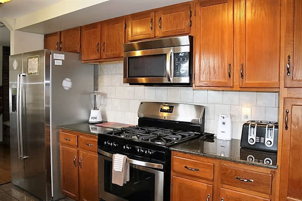 Stainless steel appliances, gas stove and over the range microwave