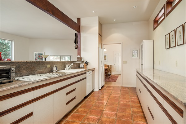 kitchen - open to dining room (double oven, dishwasher & fridge have all been upgraded after this photo)