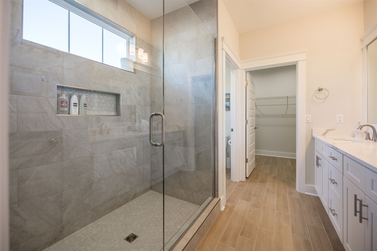 Large shower with handheld shower head