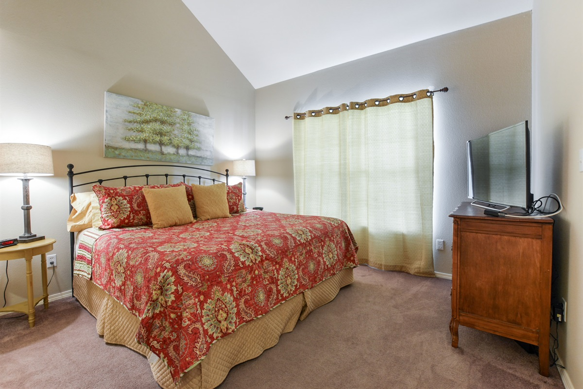 The second bedroom also features a king bed and private TV