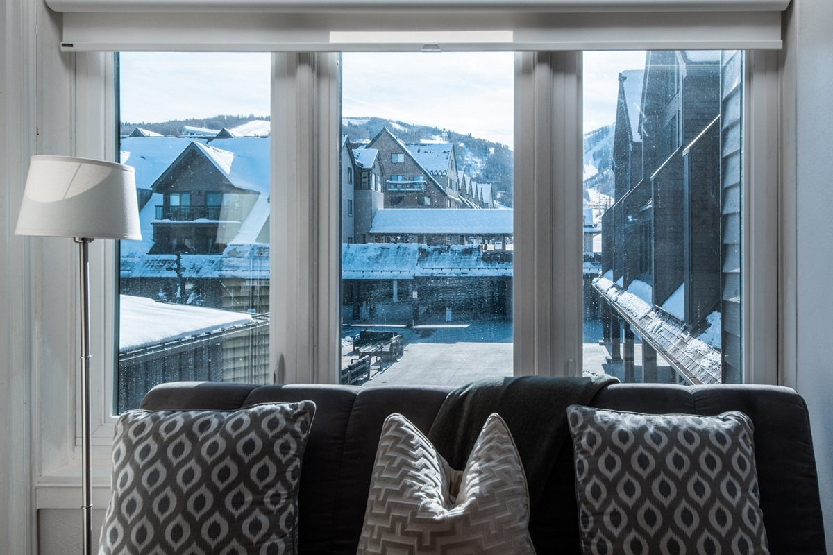 Enjoy a cozy moment overlooking the ice rink and plaza below, or fold down to form a small, double bed. Great for one adult or two kids.