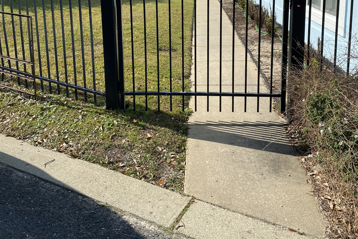 Gate to walkway entry.