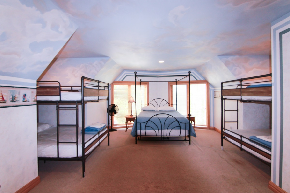 Bedroom 5 has FIVE queen beds! One queen canopy, and two queen over queen bunk beds! Super bright and airy makes this bedroom a true retreat.