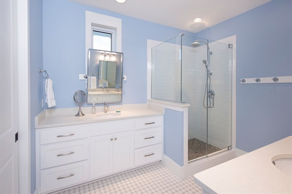 2nd Floor Master Bath with 2 sinks, shower, and closet with large chest